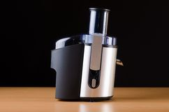 The juice extractor in kitchenware concept. Juice extractor in kitchenware concept Stock Photography