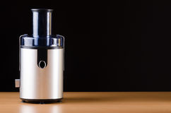 The juice extractor in kitchenware concept Stock Photos