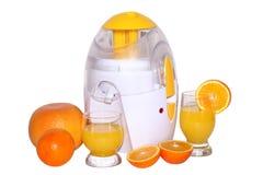 Juice extractor and oranges. Juice extractor, oranges and orange juice Royalty Free Stock Images
