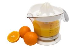 Juice extractor and ripe oranges Royalty Free Stock Image