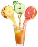 Juice flowing into the glass. royalty free stock photos