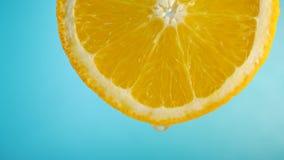 Juice Flows Down on Orange Fruit. On Green Background. Citrus juice concept stock video footage