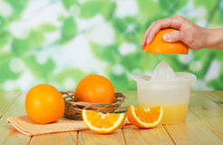 Juice and fresh orange on table Royalty Free Stock Photo
