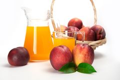 Juice and fresh peaches  on white background.  Royalty Free Stock Images