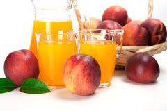 Juice and fresh peaches  on white background.  Royalty Free Stock Photos