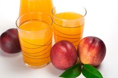 Juice and fresh peaches  on white background.  Stock Image