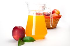 Juice and fresh peaches  on white background.  Stock Images