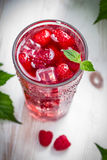 Juice of fresh raspberries with ice. Closeup of Juice of fresh raspberries with ice Royalty Free Stock Photo