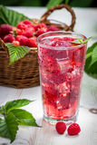 Juice of fresh raspberries with ice. On old table Royalty Free Stock Photos