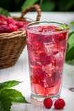 Juice of fresh raspberries with ice. On old wooden table Royalty Free Stock Photo