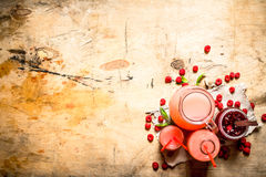 The juice of fresh raspberries and jam. On a wooden table Stock Images