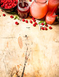 The juice of fresh raspberries and jam. On a wooden table Royalty Free Stock Image