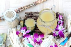 Juice of fresh sugar cane for drinks and sugar. Royalty Free Stock Image