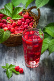 Juice from freshly harvested raspberries with ice royalty free stock images