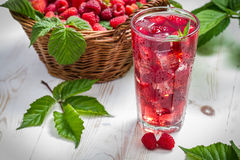 Juice from freshly harvested raspberries served with ice Royalty Free Stock Photo