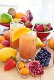 Juice From Various Fresh Fruits Stock Photos
