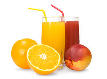 Juice and fruit. Two glasses of juice , oranges and peaches royalty free stock images