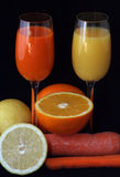 Juice and fruit. Glasses of fruit juice next to slices of fruit stock photos