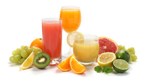 Juice and fruits. Glasses of fruit juice with fruits on a white background Royalty Free Stock Photo