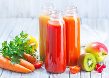 Juice. From fruits and vegetables in bottle Stock Images
