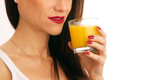 Orange Juice in Glass Held by Manicured Girl Stock Photos