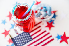 Juice glass and american flag on independence day Stock Images