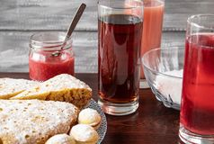Juice in a glass in the background, a pie on a bowl and jam in a small jar royalty free stock photos