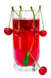 Juice glass with cherries Royalty Free Stock Photography