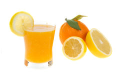 Juice in glass with citrus fresh fruit Royalty Free Stock Images