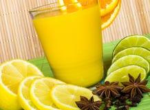 Juice in the glass. Grapefruit Orange Lime Lemon Juice Stock Photos