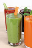 Juice. Glass of vegetable juice on wooden table Royalty Free Stock Image