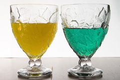 Juice glasses. Details of two juice glasses filled with tasty, nutritious fruit juices Stock Photo