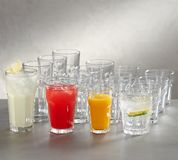 Juice glasses - empty, red juice , white juice and rose juice . stock image