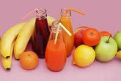 Juice Glasses of freshly Fruit juice with colorful fruits on Pink Background. Banner. Healthy Food Concept. Stock Images