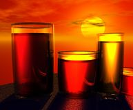 Juice Glasses at Sunset. Glasses with liquid, at sunset. Orange illustration Royalty Free Stock Photography