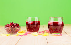 Juice with grains of a pomegranate. Royalty Free Stock Images