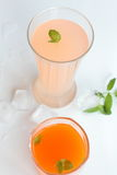 Juice. Grapefruit and carrot juice with ice and mint Royalty Free Stock Photography