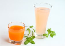 Juice. Grapefruit and carrot juice with ice and mint Royalty Free Stock Images