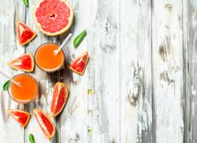 Juice and grapefruit slices stock image