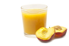 Juice and half peaches Stock Images