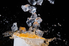 Juice And Ice On A Black Background Stock Photos