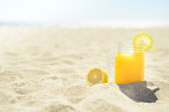 Juice in a jar on the beach Royalty Free Stock Photos