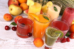 Juice with kiwi, apricot, cherry, watermelon, tangerine and pear Royalty Free Stock Photo