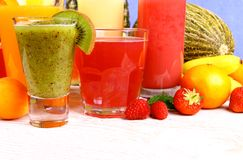 Juice with kiwi, apricot, raspberries, strawberry and banana Stock Photos