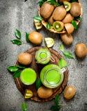 The juice of kiwi fruit with slice of fruit. Stock Images