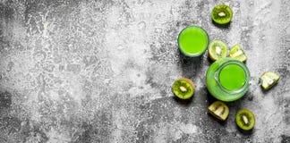 The juice of kiwi fruit with slice of fruit. Stock Image