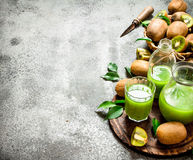 The juice of kiwi fruit with slice of fruit. Stock Photo