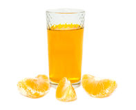 Juice with the lobules of orange Royalty Free Stock Photography