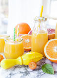 Juice made from fresh citrus fruits Royalty Free Stock Images