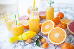 Juice made from fresh citrus fruits. Fresh pressed juice from colorful citrus fruits stock image